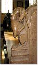 A unicorn on a bench end - St. Mary's, Old Hunstanton